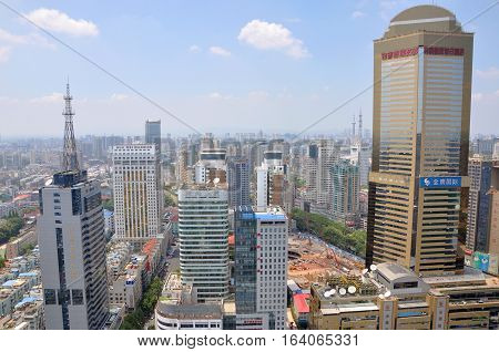 NANJING, CHINA - AUG. 6, 2012: Aerial view of Nanjing City center skyline (West) with Jinying (Golden Eagle) shopping mall on the right, viewed from Xinjiekou CBD, Nanjing, Jiangsu Province, China.