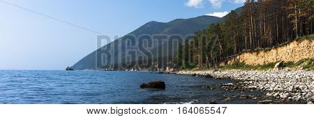 The landscape is mountainous coast of lake Baikal, is covered with coniferous forest, which descends directly to the water.