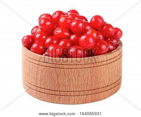 ripe red viburnum berries in a wooden bowl isolated on white background.