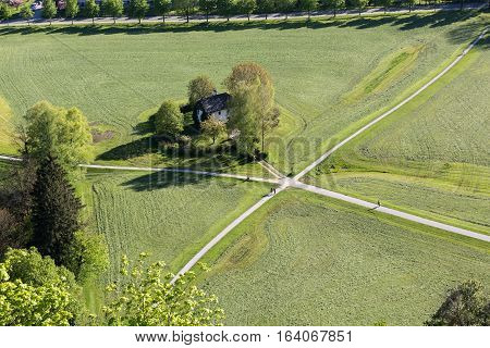 Aerial panoramic view from the top of Hohensalzburg fortress (Castle) on cultivated land divided by the crossing ways (roads). Salzburg Austria