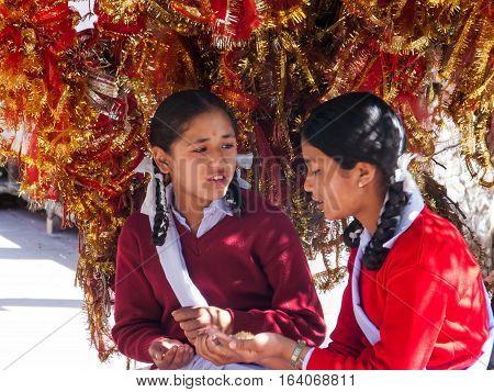 DHARAMSALA, INDIA. 2 Jun 2009: Daily lifestyle. Hindu school girls in the temple, pray before a test in school. Western Himalayas, Himachal Pradesh, district of Kangra.