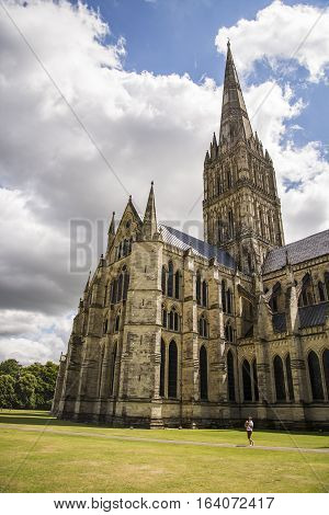 SALISBURY - JULY 19: the famous view of the Cathedral and park on sunny and cloudy day on July 17 2015 in Salisbury in South England