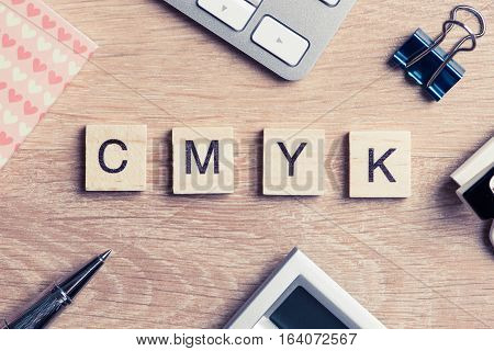 Word cmyk collected of game wooden cubes