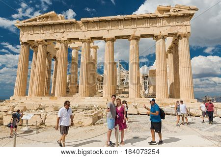 Athens, Greece - SEPTEMBER 2016: A lot of tourists around the Parthenon in Acropolis Complex