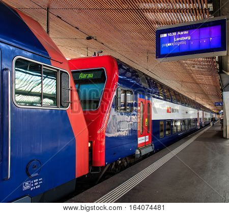Zurich, Switzerland - 7 July, 2016: a train heading to the towns of Aarau and Lenzburg at a platform of the Zurich Main railway station. Zurich Main railway station is the largest railway station in Switzerland.