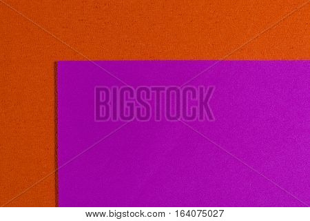 Eva foam ethylene vinyl acetate smooth pink surface on orange sponge plush background