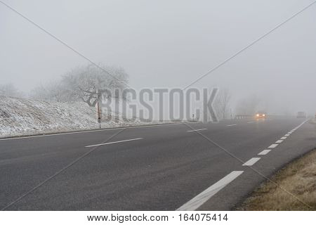 Road traffic in fog and slippery road