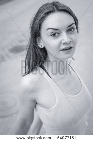 The Girl With Big Eyes And Bare Shoulders Looks Into The Camera. Outdoor , Closeup