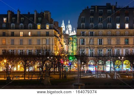 Night view of Sacre-Coeur Basilica or Basilica of the Sacred Heart of Jesus and Tuileries Garden, Paris, France