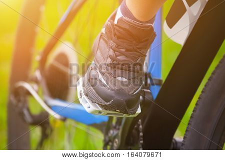 Athlete - Cyclist Keeps His Feet In Running Shoes On The Pedals Of His Vehicle While Driving. The Co