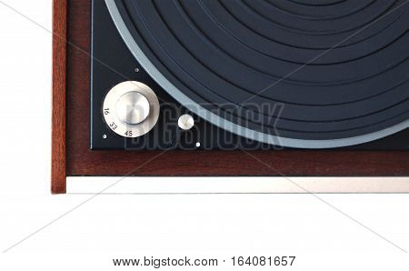 Part of vintage record player with wood finish top view isolated on white horizontal photo closeup