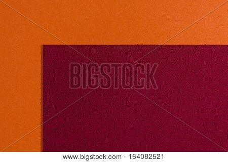 Eva foam ethylene vinyl acetate sponge red surface on orange smooth background