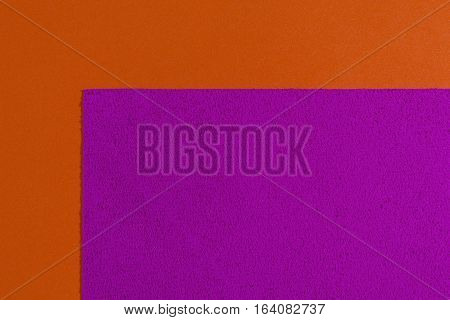 Eva foam ethylene vinyl acetate sponge pink surface on orange smooth background