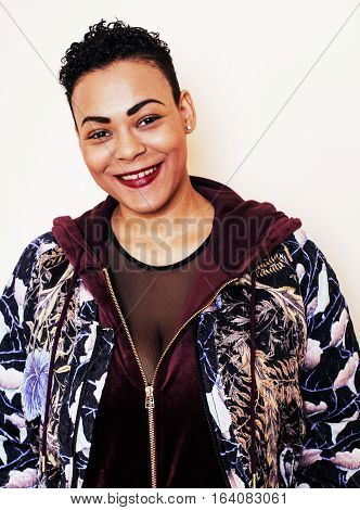 young pretty mulatto woman with modern haircut fancy dressed, posing smiling, fashion concept, lifestyle people