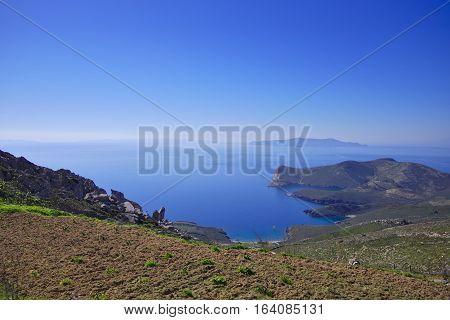 Dry Mediterranean island coast scenery. Greek travel destinations poster.