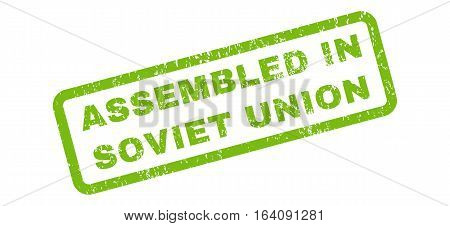 Assembled In Soviet Union text rubber seal stamp watermark. Tag inside rectangular banner with grunge design and scratched texture. Slanted glyph light green ink sign on a white background.