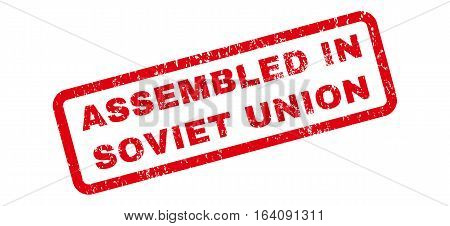 Assembled In Soviet Union text rubber seal stamp watermark. Tag inside rectangular shape with grunge design and unclean texture. Slanted glyph red ink emblem on a white background.