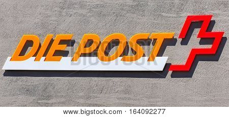Aarau, Switzerland - 7 July, 2016: Swiss Post sign on the wall of a post office. Swiss Post a public company, which provides national postal service for Switzerland.