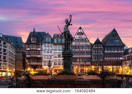 Frankfurt Old town square romerberg with Justitia statue in Frankfurt Germany.