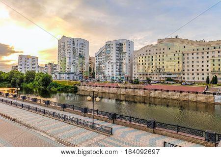 BELGOROD RUSSIA - JULY 04 2016: Belgorod State University Embankment overlooking the student residence and left-bank residential neighborhood. Belgorod cityscape on the sunset.