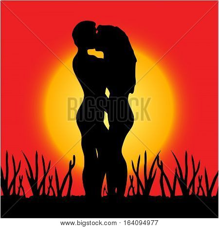 Couple in love kissing on sunset background
