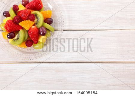 Fruit salad mixed fresh fruits with copyspace.