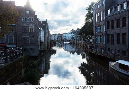 Leie river runs between the buildings in a medieval city of Ghent, Belgium