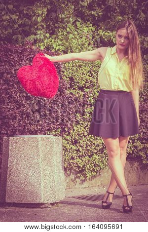 Sad Woman Throwing Out Heart