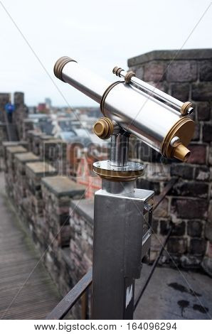 Telescope on top of a castle to view the city