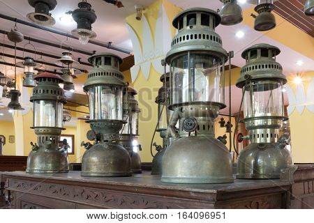 Group Of Old Vintage Storm Lanterns, Hurricane Lamp Put On Vintage Cabinet Wood. Vintage Lamp Concep