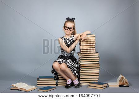 Smart Girl With A Stack Of Books.