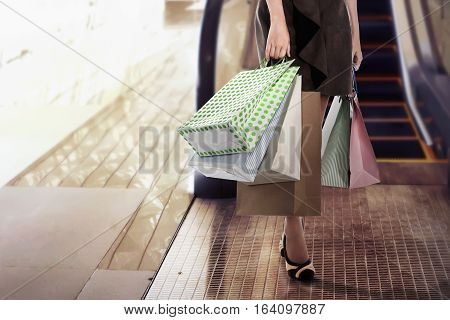 Close-up Of Young Woman Carrying Shopping Bags