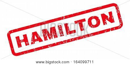 Hamilton text rubber seal stamp watermark. Tag inside rounded rectangular shape with grunge design and scratched texture. Slanted glyph red ink emblem on a white background.