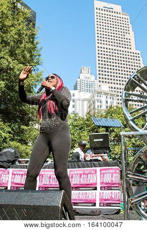 ATLANTA, GA - OCTOBER 2016:  Female hip hop artist Knocka DonDiva performs on the stage at Atlanta Hip Hop Day a free festival open to the public at Woodruff Park in downtown Atlanta in Atlanta GA on October 8 2016.