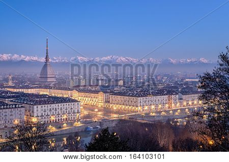 Turin high definition panorama at blue hour with Mole Antonelliana Piazza Vittorio and the Alps in the background