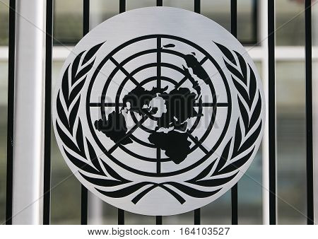 New York, July 19, 2016: A black and white UN logo attached to a fence of the United Nations campus.