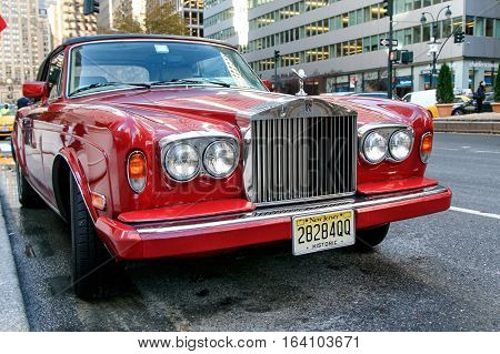New York December 1 2016: A red Rolls Royce is parked on Park Avenue in Manhattan.