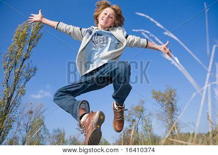 Happy jumping boy