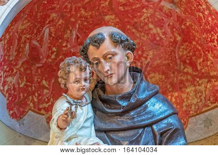 TUCEPI, CROATIA - September 21, 2016: Saint Anthony with Child statue, part of the interior of the Church of St. Anthony in old village in Dalmatia.