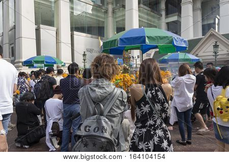 BANGKOKTHAILAND - DEC 31 : snapshot of people pray at Erawan shrine in ratchaprasong area on december 31 2016 Thailand. there are many tourist worship at Erawan shrine in new year festival