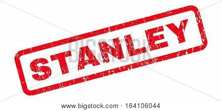 Stanley text rubber seal stamp watermark. Tag inside rounded rectangular banner with grunge design and dust texture. Slanted glyph red ink emblem on a white background.