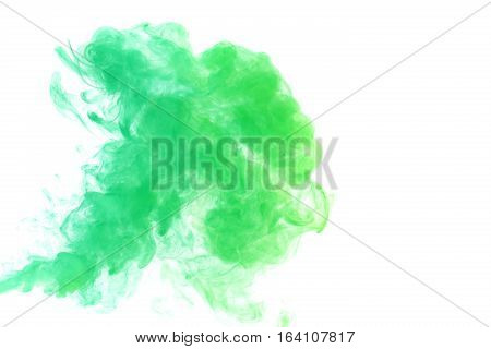 Abstract smoke Weipa. Personal vaporizers fragrant steam. The concept of alternative non-nicotine smoking. Green vape smoke on a white background. E-cigarette. Evaporator. Taking Close-up. Vaping.