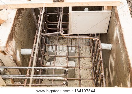 The concrete formwork and reinforcement steel for construction foundation.