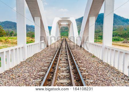 Seeing Through the White Concrete Railway Bridge