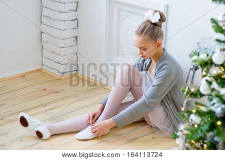 Young Ballet Dancer Sitting Near Christmas Tree