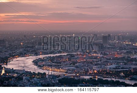 Arial view of Bangkok city at sunset. Grand palace and Wat Phra Kaeo