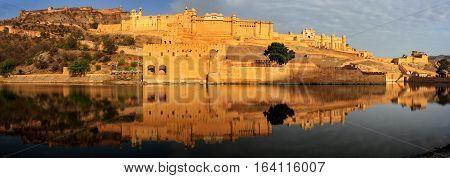 Panorama Of Amber Fort Reflected In Maota Lake Near Jaipur, Rajasthan, India.