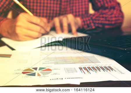 Man Writing And Make Note About Cost Anual And Expenses At Home Office. Finance Concept.