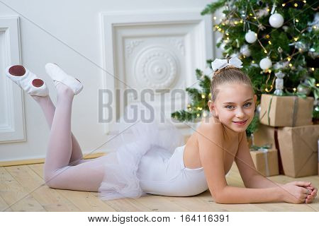 Young Ballet Dancer Lying Near Christmas Tree