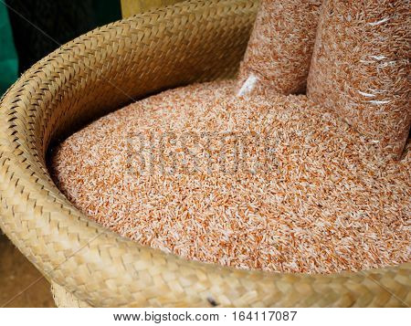 Raw Purple Riceberry rice or brown rice in bamboo weave basket